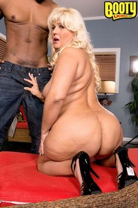 Big booty MILF Lori Suarez is horny for big black dick